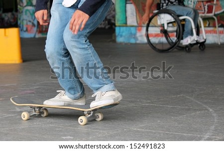 Young teen on skateboard in graffiti skate park  - stock photo