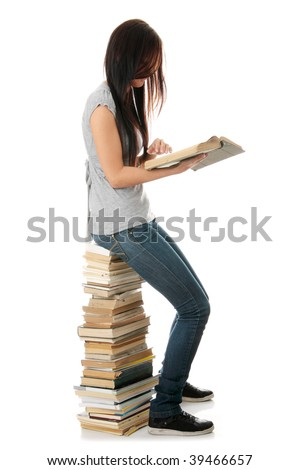 Young teen woman sitting on books isolated - stock photo