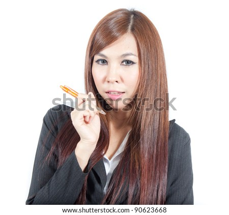 Young teen woman with a pen - stock photo