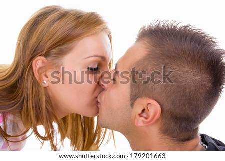 young teenage couple in love kissing - stock photo