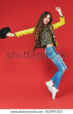 young teenage-girl dancing in laserbeam-discolight - stock photo