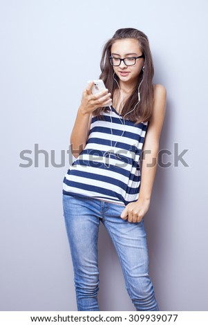 Young teenage girl posing, listening to music. Photo at home. Happiness content. - stock photo