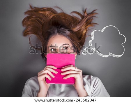 Young teenage girl with cellphone thinking - stock photo