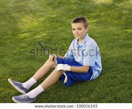 Young Teenage Golfer - stock photo