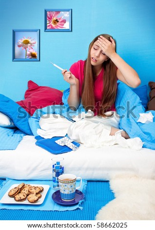 young teenage-woman is sick in bed (my flower photos) - stock photo