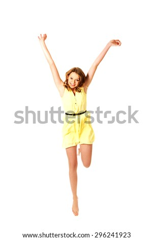 Young teenage woman jumping for joy - stock photo