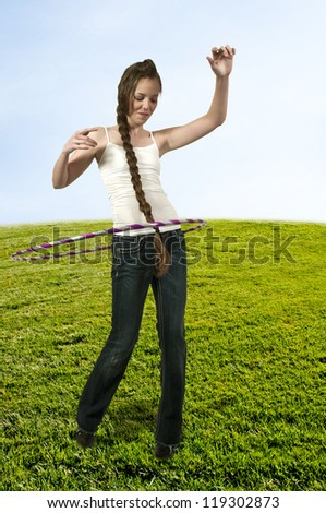 Young teenage woman with a hula hoop - stock photo