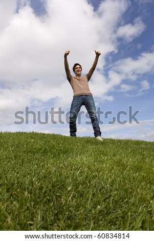 young teenager enjoying the fresh air in the park - stock photo