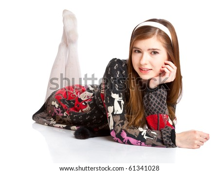 Young teenager girl lie on a floor. Isolated on white background - stock photo