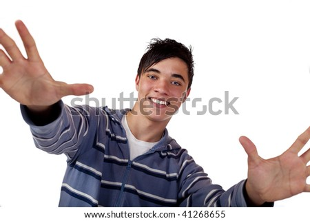 Young teenager with open arms smiles and looks straight into camera. Isolated on white. - stock photo