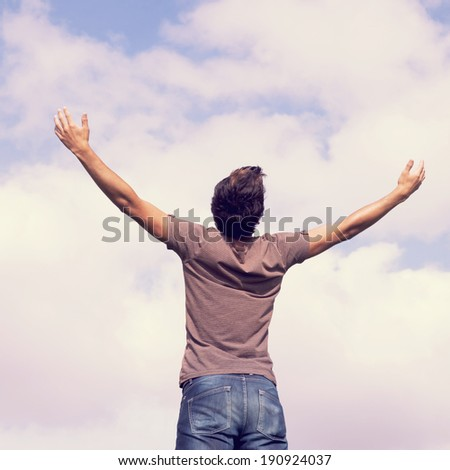 young teenager with the arms outstretched in outdoor - stock photo