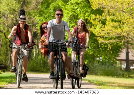 Young teenagers are making a trip with the bicycles - stock photo
