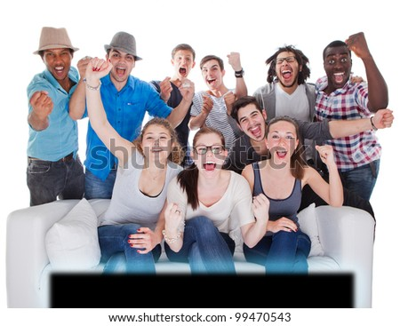 Young teenagers going crazy in front of TV. Isolated over white. - stock photo