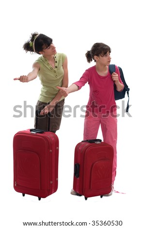Young teenagers with huge luggages wave for a taxi - stock photo
