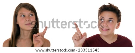 Young teens or children pointing with their finger, isolated on a white background - stock photo