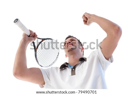 Young tennis player happy for scoring, clenching fists, holding tennis racket.? - stock photo