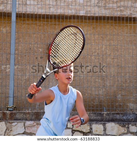 Young tennis player in action . - stock photo