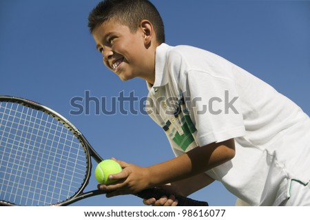 Young Tennis Player Preparing to Serve - stock photo