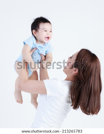 Young Thai mom and son smile happily isolated - stock photo