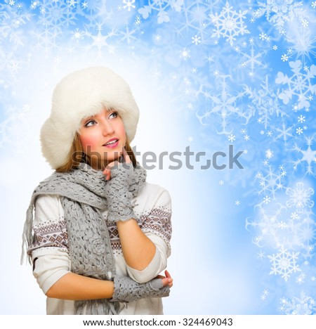 Young thinking girl on winter background - stock photo