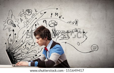 Young thoughtful man using laptop. Idea concept - stock photo
