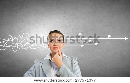 Young thoughtful woman and ideas coming out of her head - stock photo