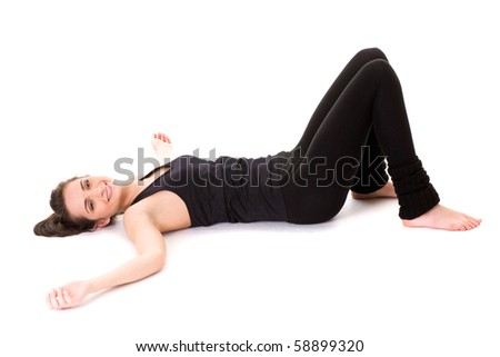 young tired and exhausted female in fitness outfit lies on white floor, studio shoot isolated on white - stock photo