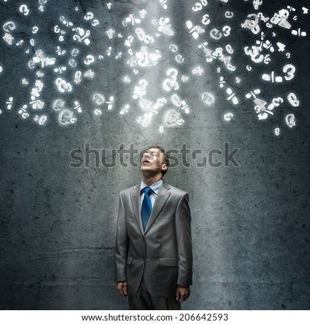 Young tired businessman standing with closed eyes - stock photo