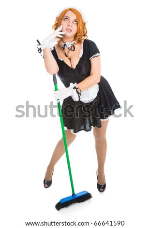 young tired housemaid with apron and broom - stock photo