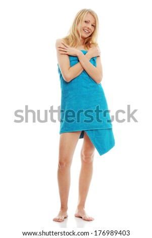 Young topless caucasian woman with blue towel isolated on white background  - stock photo