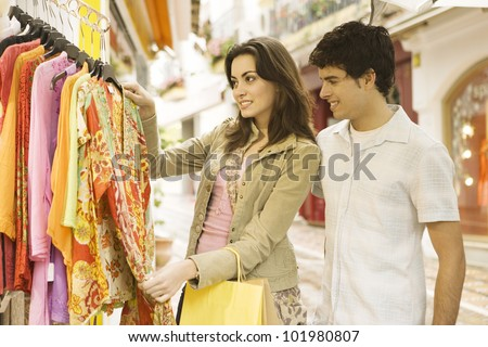 Young tourist couple shopping for souvenirs in a vacations destination. - stock photo