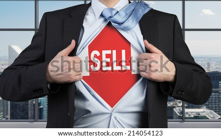 Young trader making choice to sell shares. - stock photo