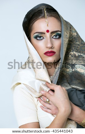 Young traditional Asian Indian woman in indian  sari, isolated on white background - stock photo