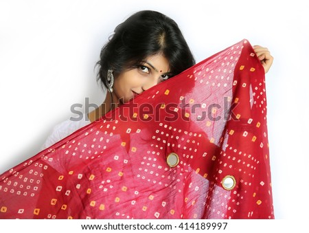 Young traditional Indian woman portrait with dupatta getting shy - stock photo