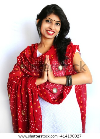 Young traditional Indian woman portrait with dupatta  showing namaste - stock photo