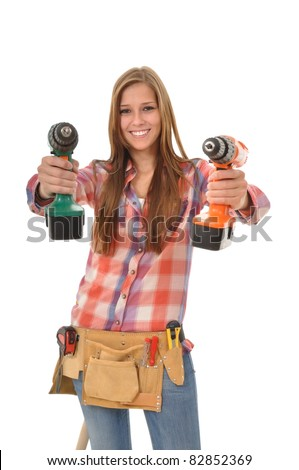 Young trainees holding two screwdrivers into the camera - stock photo