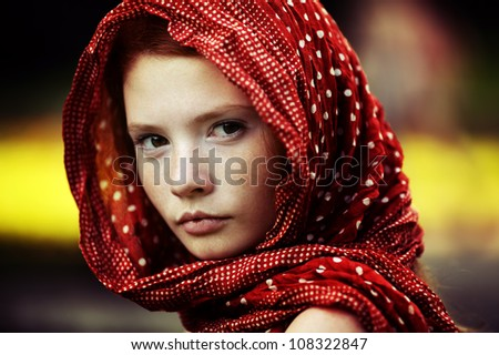 Young tranquil woman outdoors portrait - stock photo