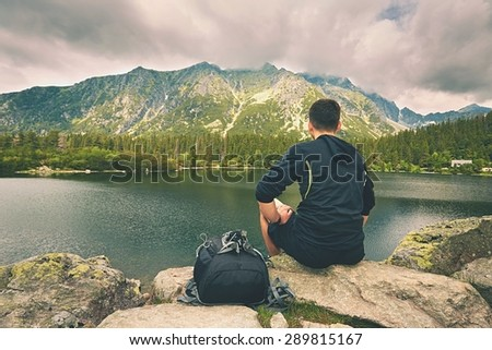Young traveler is relaxing in the mountains - stock photo