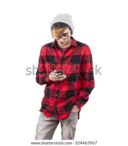 young trendy guy texting on his smartphone on white background - stock photo