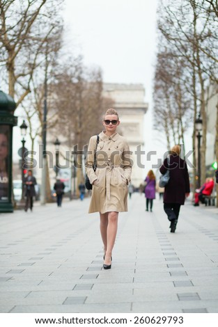 Young trendy Parisian woman in the street - stock photo