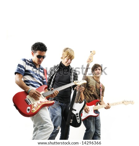 Young trendy team playing electric bass and guitars - isolated - stock photo