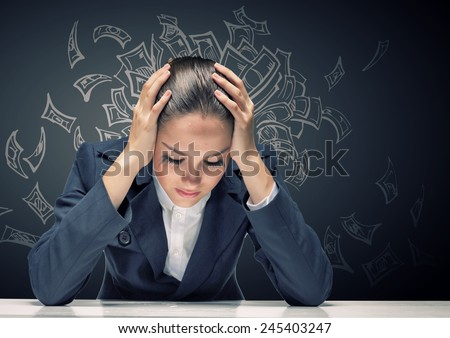 Young troubled businesswoman with hands on head - stock photo
