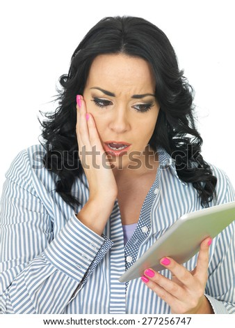 Young Upset Scared Attractive Woman Using a Tablet - stock photo