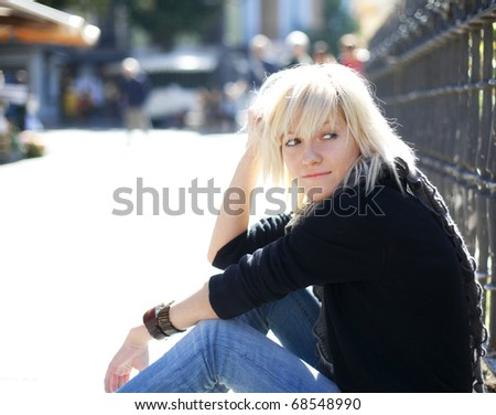 Young urban blond girl staring at something - stock photo