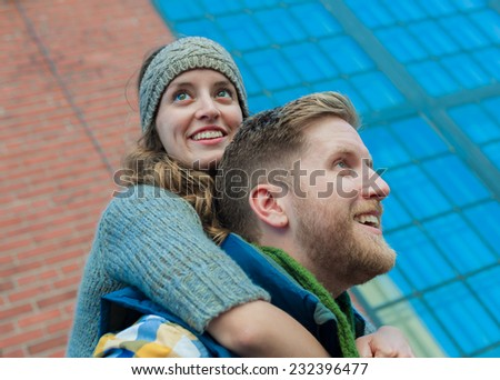 Young urban couple during cold weather months. - stock photo