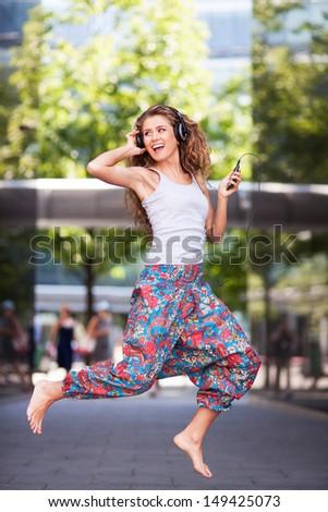 Young urban woman jumping - stock photo