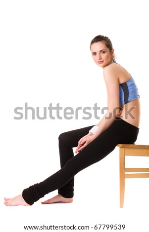 young very attractive female have some rest after exercise, sits on chair, isolated on white - stock photo