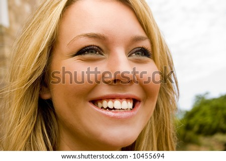 Young vibrant girl laughing - stock photo