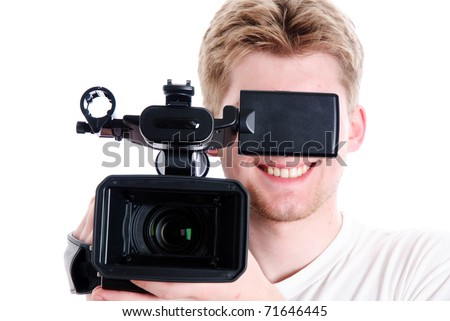 young video operator with HDV camcorder. Focus on camera - stock photo