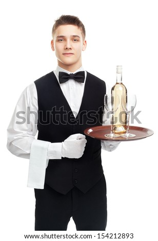 young waiter with bottle of white wine and stemware glass on tray isolated on white background - stock photo